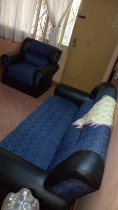 Juego de sillones en tela jackard azul y cuerina
