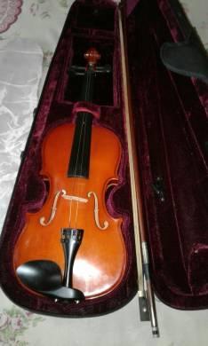 Violines semi nuevos