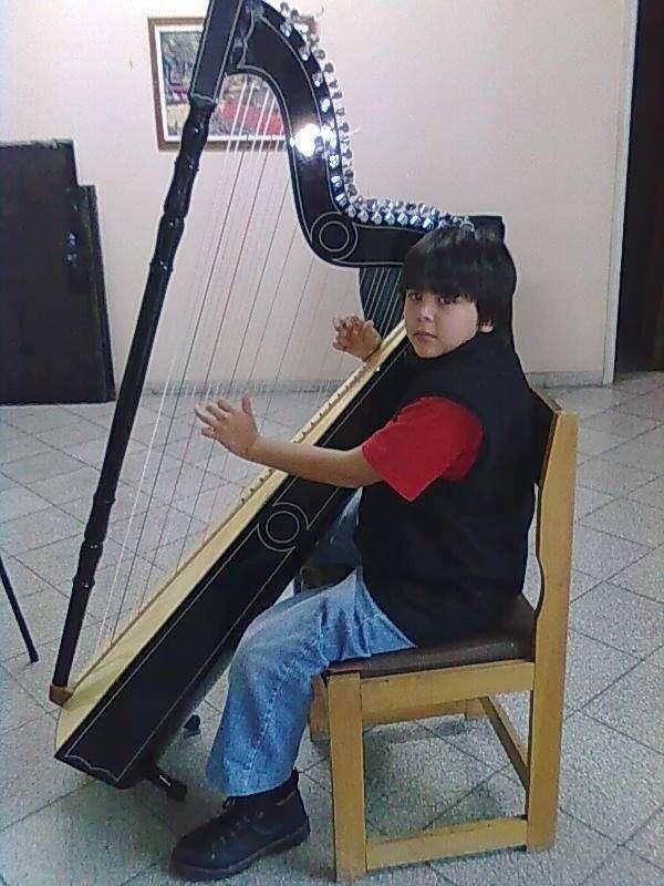 Clases de Guitarra Arpa y Vocalización - 3