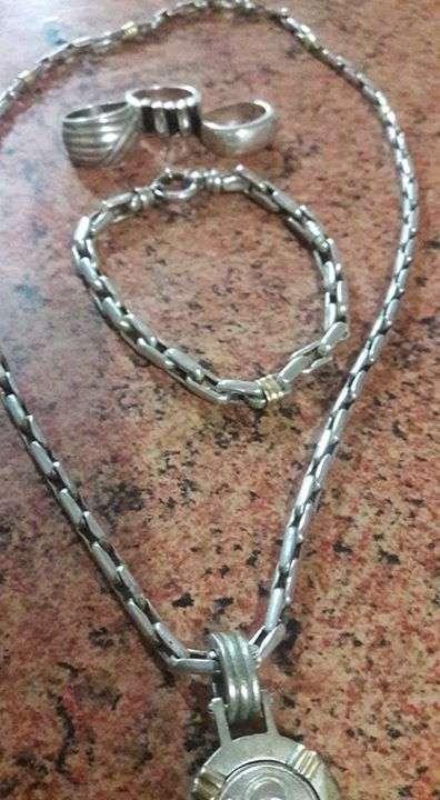 Cadena con pulsera de plata y tres anillo