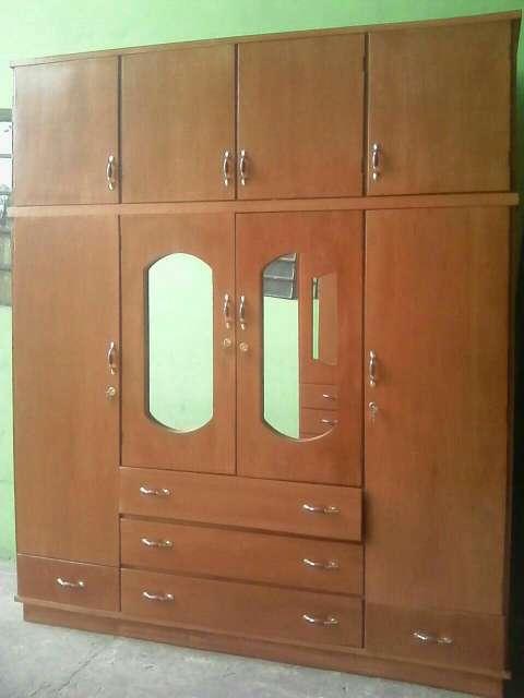Ropero de madera de 4 puertas - 0