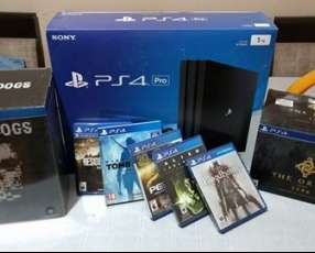 Sony PlayStation 4 Pro + 1TB + 2 controls + 4 games + PS Cam