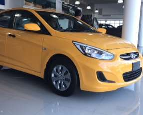 Hyundai Accent yellow sedan familiar
