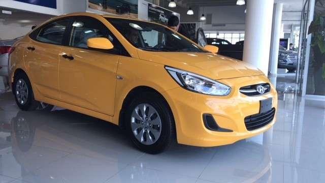Hyundai Accent yellow sedan familiar