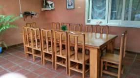 Juego de comedor con 12 sillas tapizadas