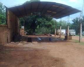 Terreno con casa y tinglado Itauguá