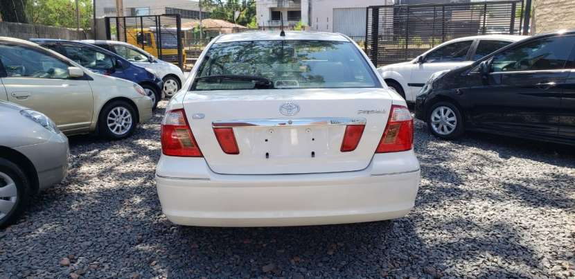 Toyota premio año 2003 color blanco perla automático - 4