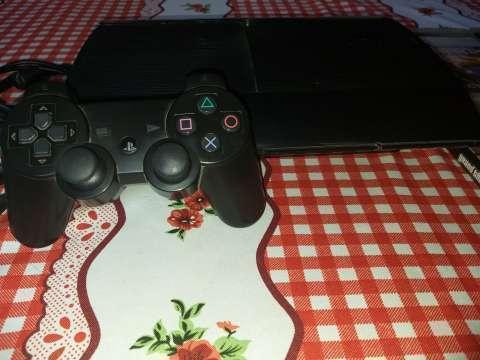 PlayStation 3 con 1 control y 4 juegos - 1