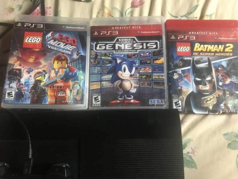 PS3 de 500 gb con tres juegos - 1