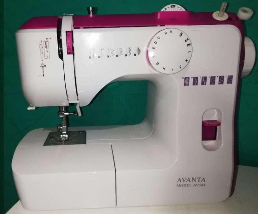 Máquina de coser familiar - 0