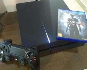 PlayStation 4 con cables y un juego