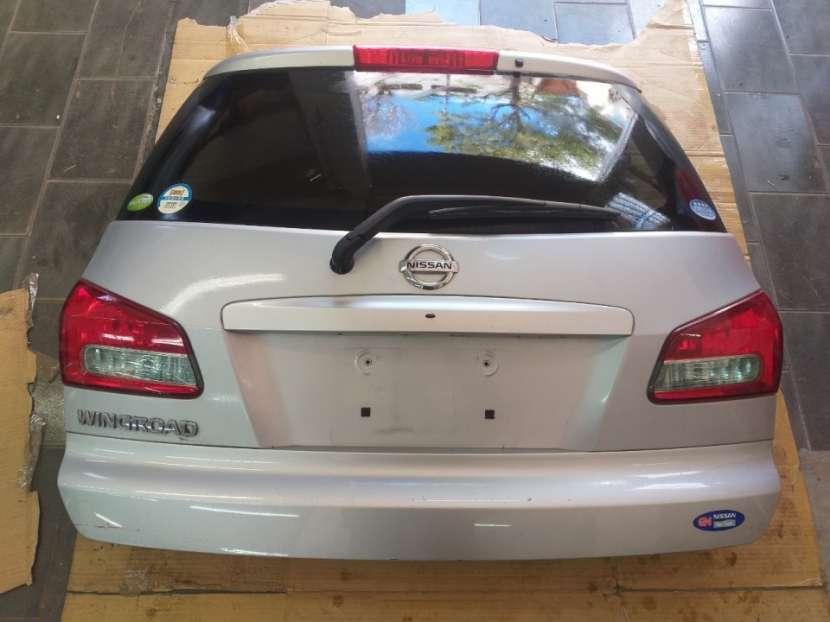Tapa trasera para Nissan Wingroad - 0