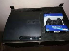 PS3 con un control y juegos cargados a elección