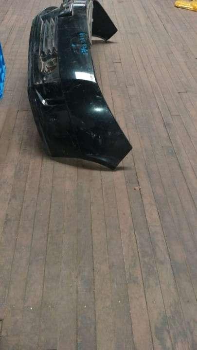 Paragolpe delantero para Nissan Wingroad negro - 0