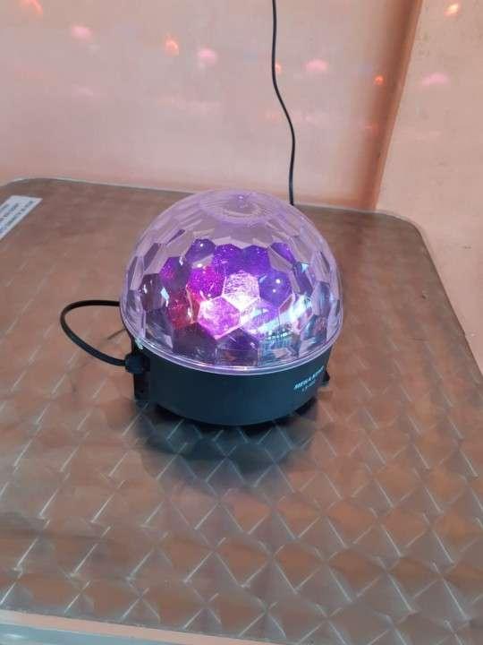 Lámpara de colores rotativa Mega Star - 1