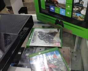 Xbox One de 500 gb con un mando afterlow y dos juegos