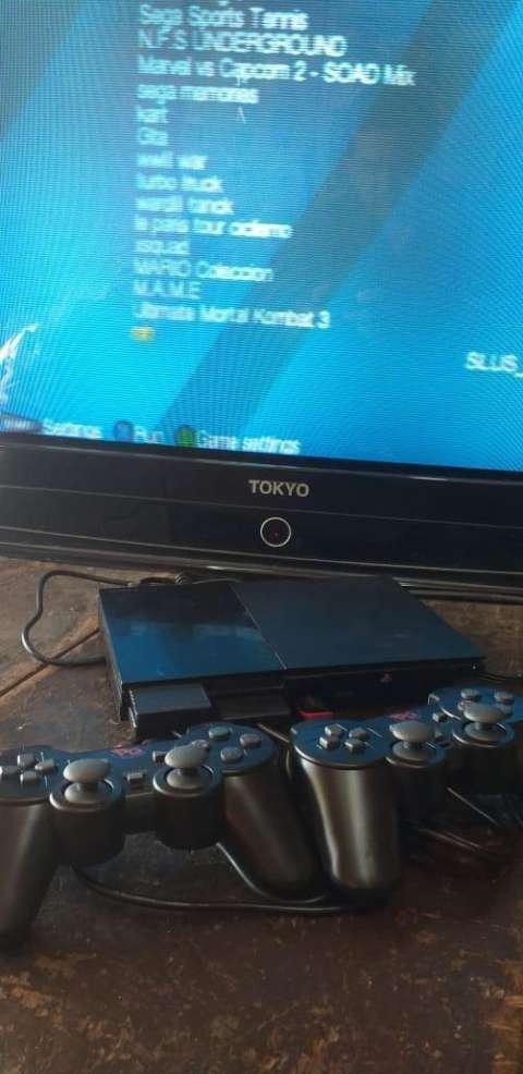 PlayStation 2 con pendrive 16 gb y 20 juegos incluidos - 2