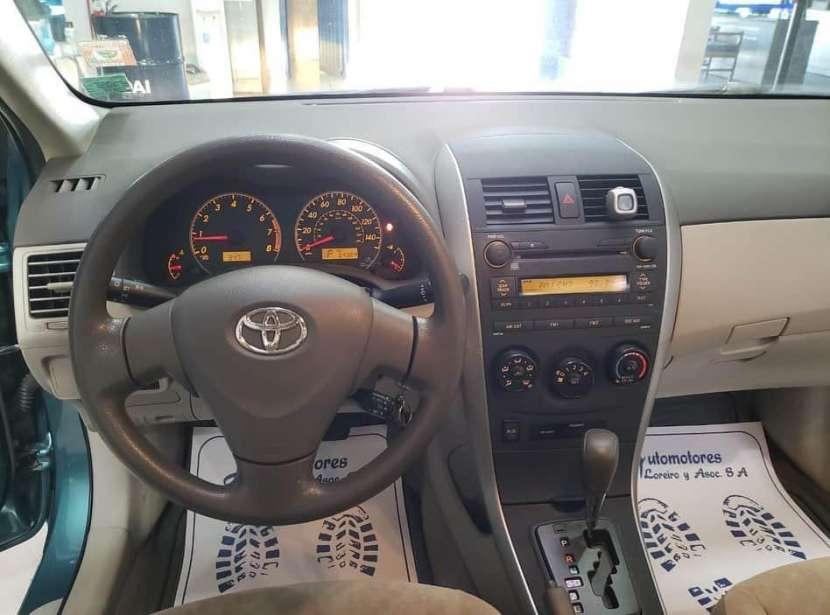 Toyota Corolla 2009 motor vvti 1.8 naftero automático - 2