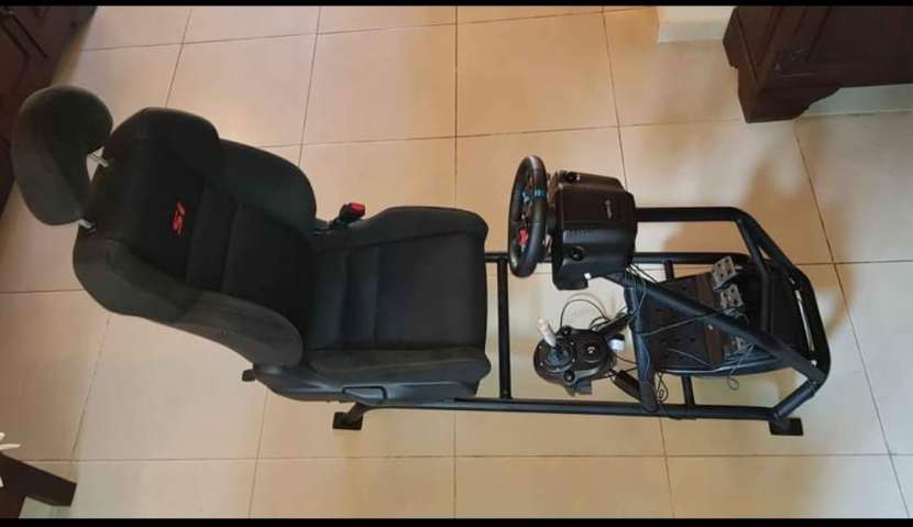Logitech G29 simulador sin uso con volante de carrera y estructura - 0