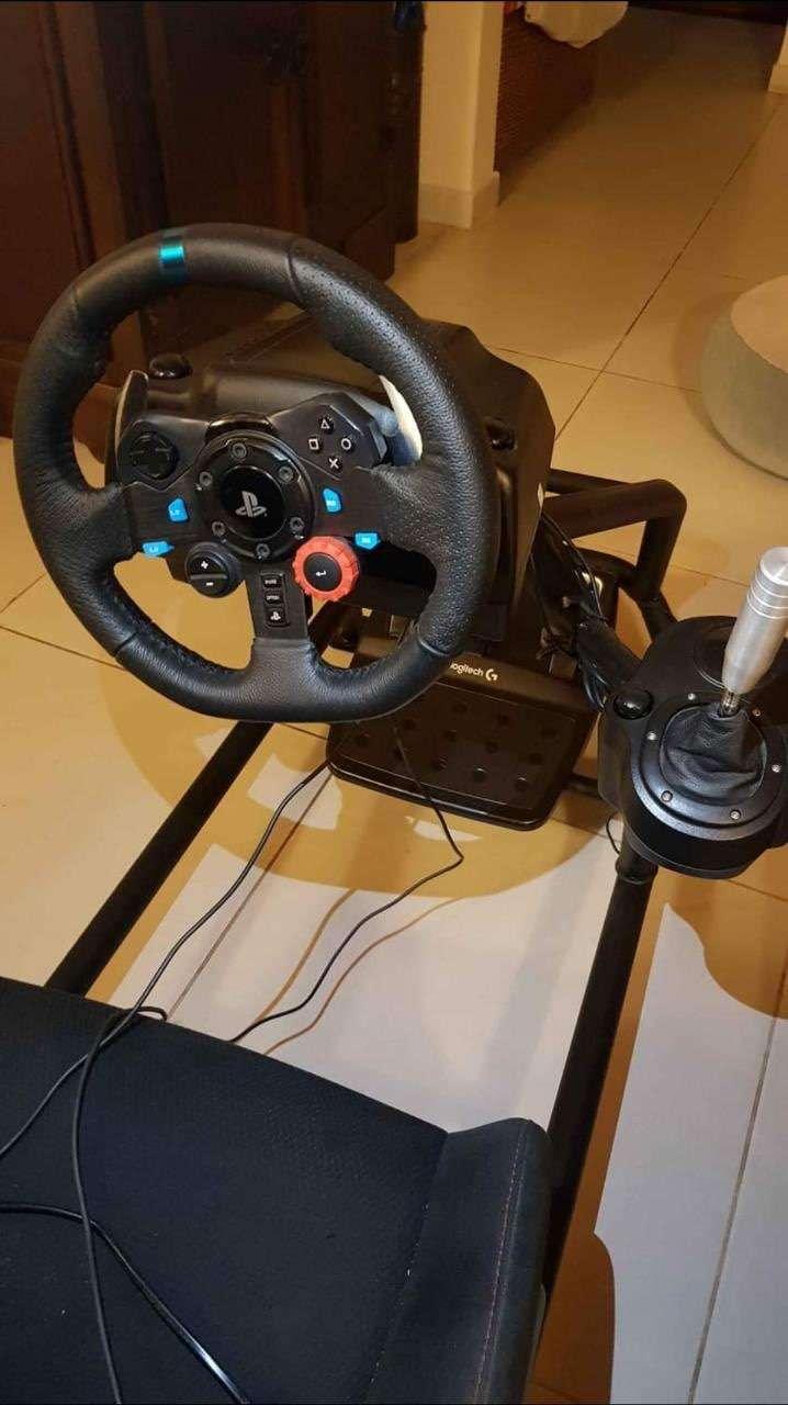 Logitech G29 simulador sin uso con volante de carrera y estructura - 1
