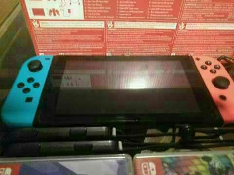 Nintendo Switch con 2 juegos y case - 1