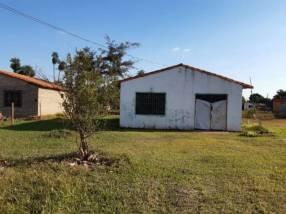 Terreno con casa en Ypané