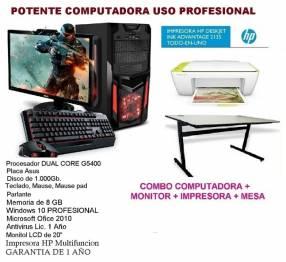 Computadora con monitor impresora y mesa
