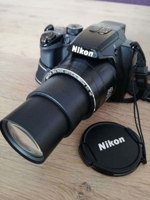 Cámara semi profesional Nikon Coolpix P100 con filmadora HD - 0