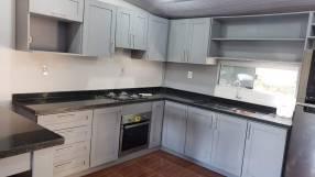 Muebles de cocina melamina y madera a la medida