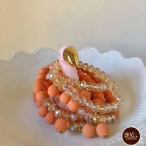 Mix pulseras naranjas con dorado