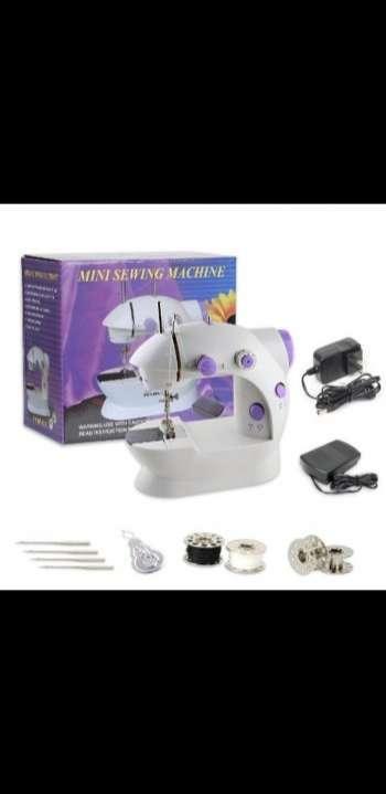 Máquina de coser portátil - 0
