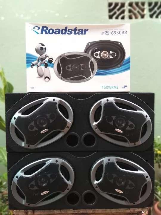 Caja + parlantes ovalados Roadstar - 0