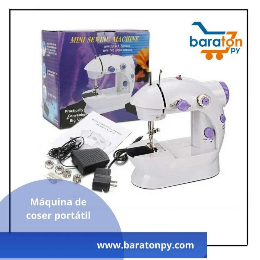 Maquina de coser portatil - 0