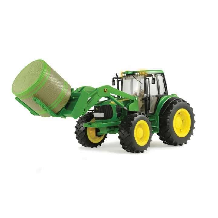 Tractor John Deere 7330 con fardos redondos - 0