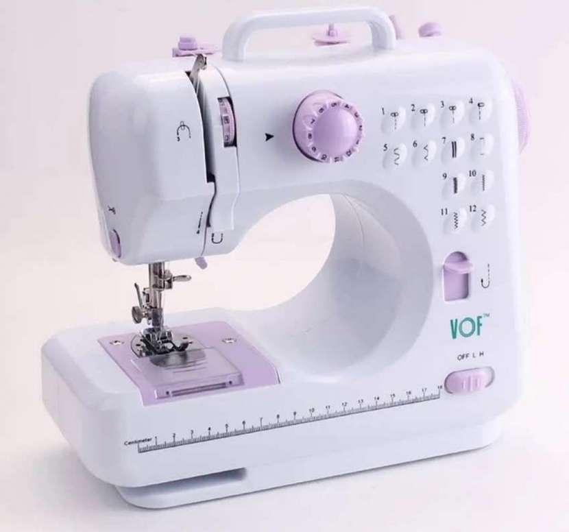 Máquina de coser eléctrica - 0
